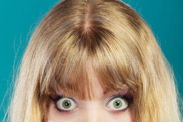 Big eyes blonde woman.