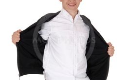 Young teen boy standing holding his jacket open