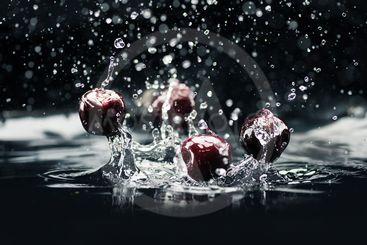 ripe cherries falling in water