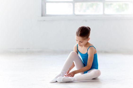 Beautiful little ballerina in blue dress for dancing...