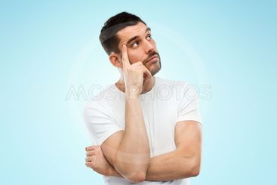 man thinking over blue background