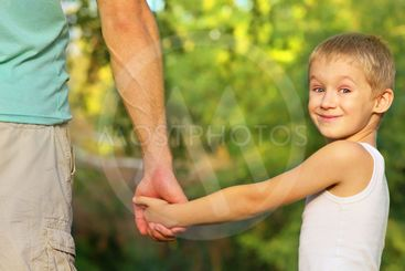 Family Father Man and Son Boy Child holding hand in hand...