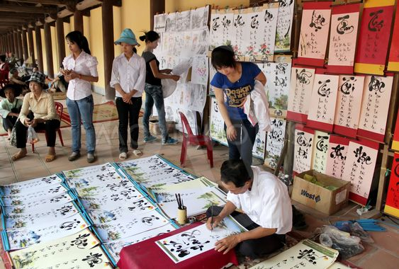 calligraphers writing the art letters