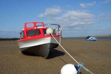 Red Boat on a Beach