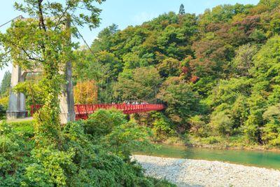 Red suspension bridge, Dakigaeri, Japan.