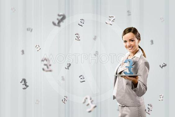 business woman holding a tablet with british pound