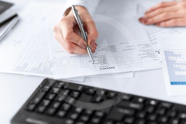 woman hand filling in invoice paper