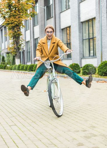 cheerful woman on bike