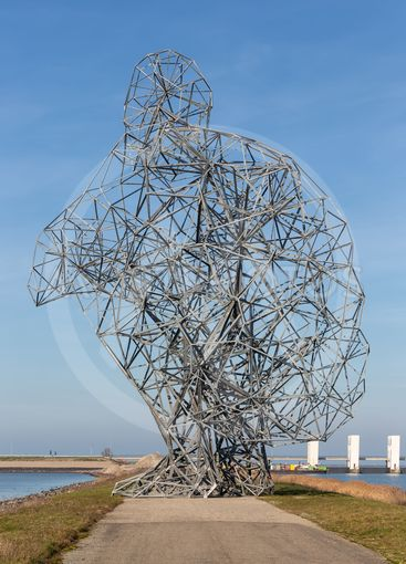 Iron statue of man on dam in Lelystad, The Netherlands