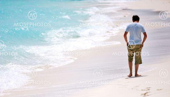 Man walking beach