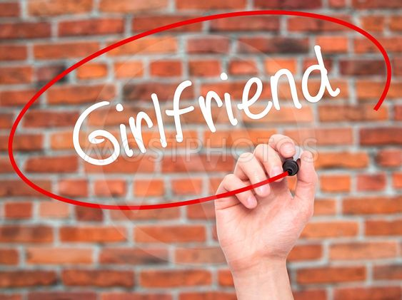 Man Hand writing Girlfriend with black marker on visual...
