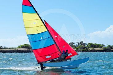Racing Cat sailing with Blue Sky.