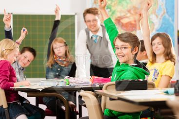 Education - Pupils and teacher learning at school