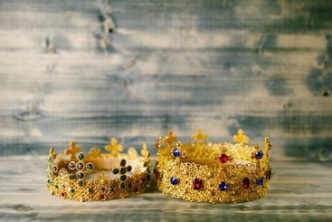 Two golden crowns for a religious wedding in an Orthodox...