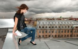 Dramatic girl with letter walking a roof