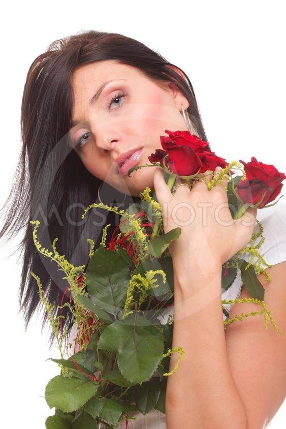 Closeup portrait of attractive young woman holding a red...