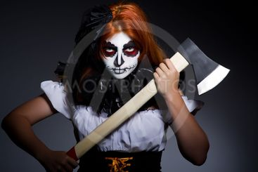 Scary woman with metal axe in halloween concept