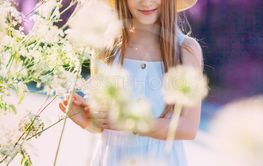 Nice smiling little girl in front of lilac background...