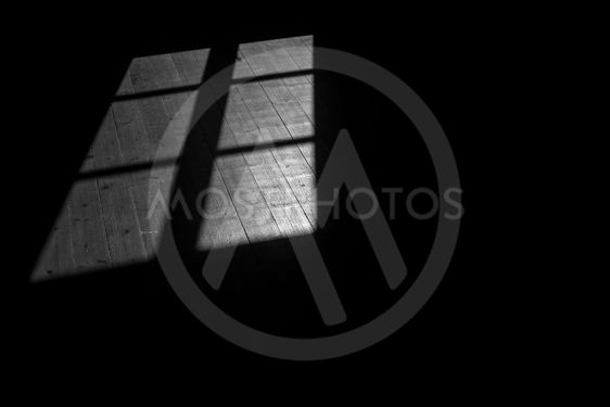 Shadow of window in black and white on old wooden floor...