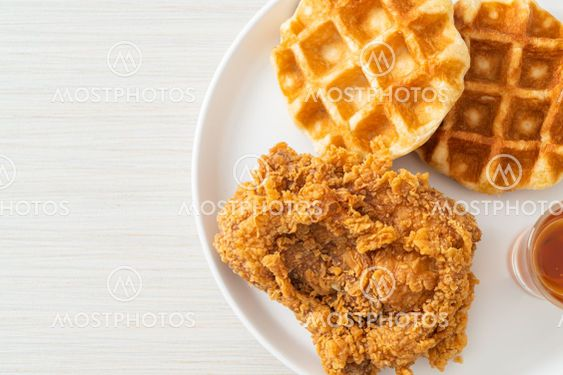 fried chicken waffle with honey or maple syrup