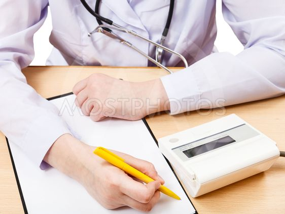 doctor measures blood pressure during appointment