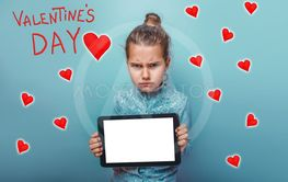 a girl holding hands tablet frowned Valentine's Day...