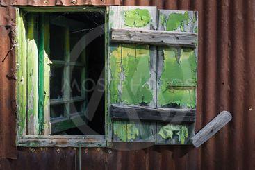 Open broken wooden window