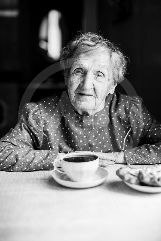 Portrait of an elderly woman with a Cup of tea....