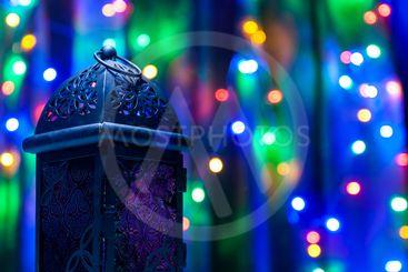 Arabic lantern on colorful light background.