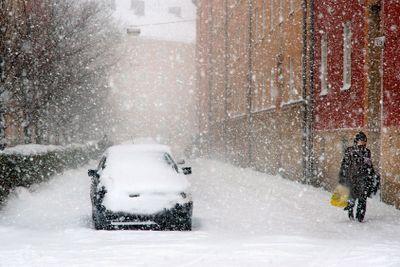 Women walking in snowstorm