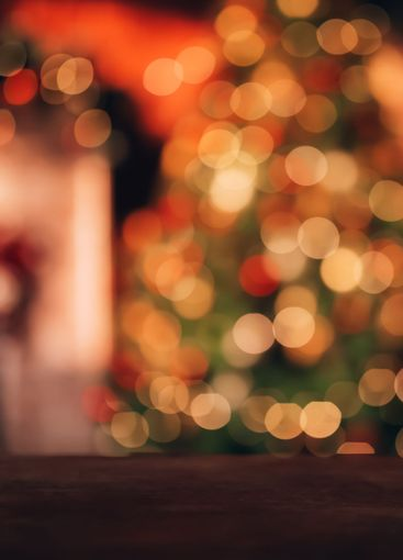 Beautiful blurred Christmas background. In the...