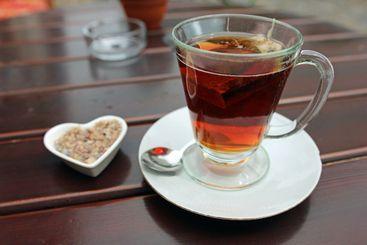 Glass cup of black tea including tea bag