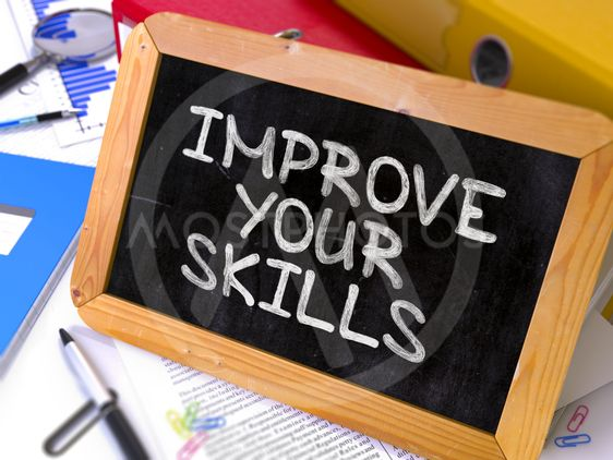 Improve Your Skills. Motivation Quote on Chalkboard.
