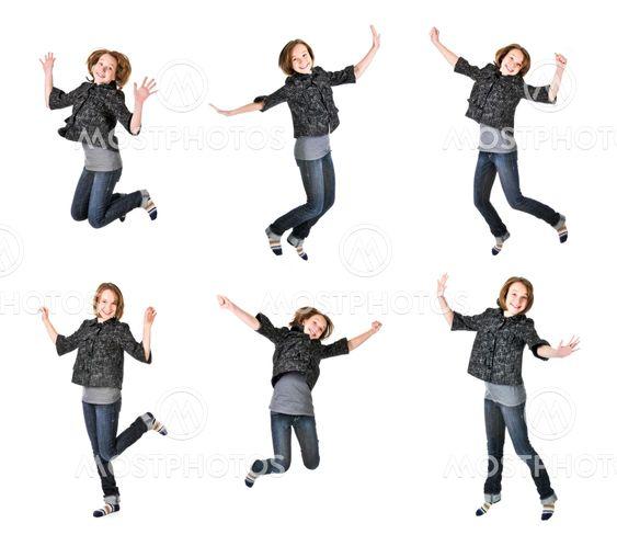 Teenage girl jumping on white background