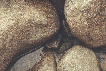 A close up of a rock in the beach