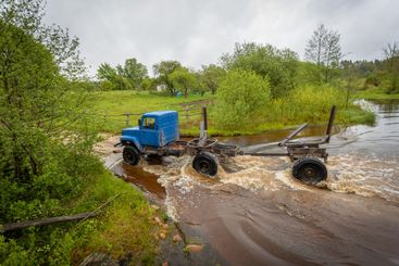 timber truck crosses the ford river