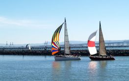 Two Sailboats under Spinnakers running into port