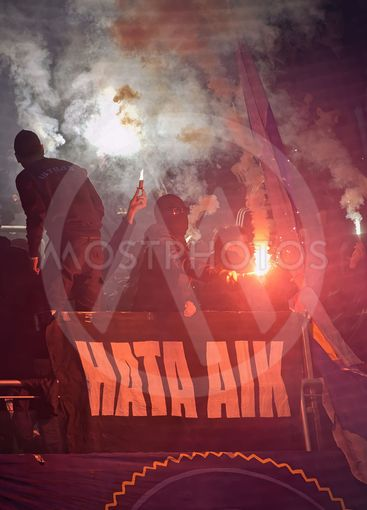 Ultras and masked people in halftime using bengal fires...