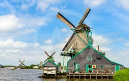 Old traditional windmill on shoreline