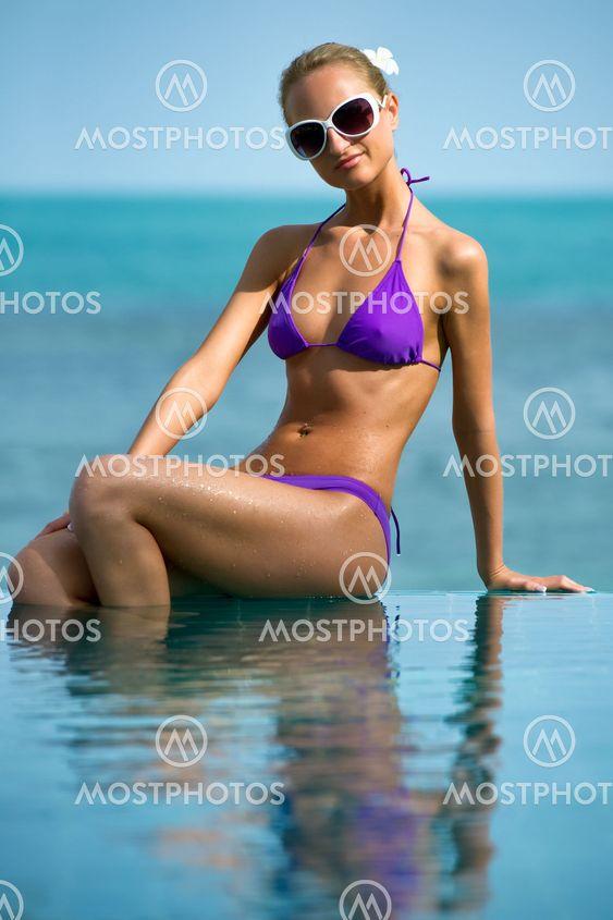 Beautiful girl relaxing in the pool