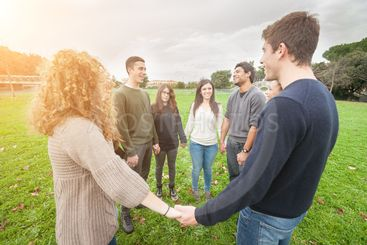 Multiethnic Group of Friends Holding Hands in a Circle