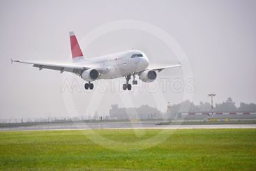 Airplane on the runway. Landing - take off at the airport