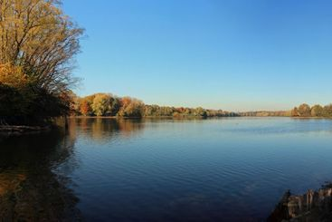 Idyllic blue clear sky above silent lake Uettelsheimer...