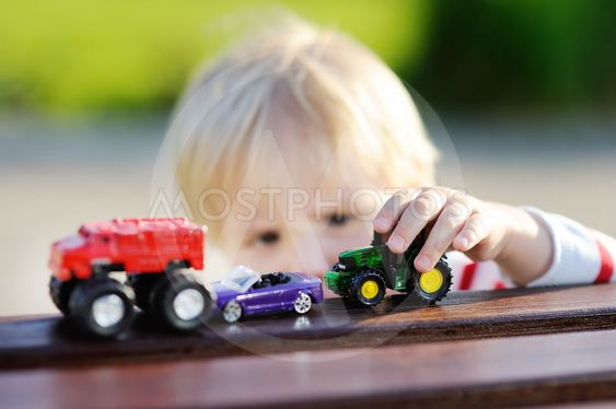 Toddler boy playing with toy cars