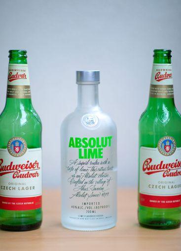 Budweiser beer bottles and vodka Absolut Lime