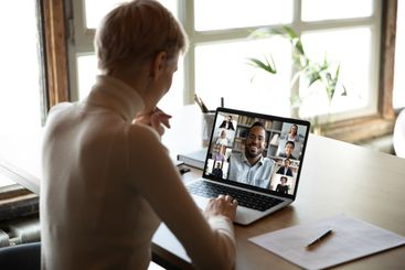 Diverse people engaged at online group meeting computer...