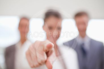 Personnel department team pointing at new employee