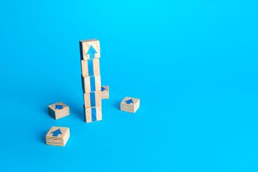Block tower with arrows. Business growth and development...