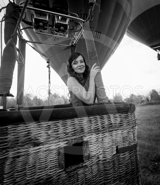 portrait of beautiful sexy woman posing at hot air...