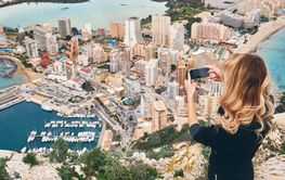Woman climbed up on Penon de Ifach rock. Enjoy view of...